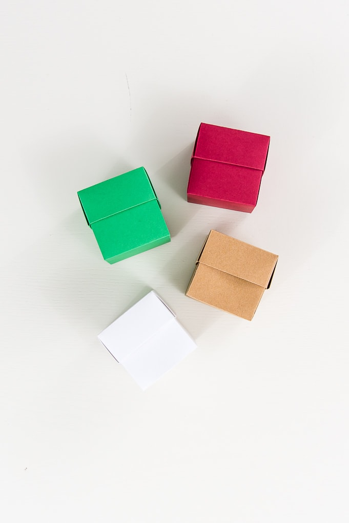 brown, white, red, and green 3D paper boxes