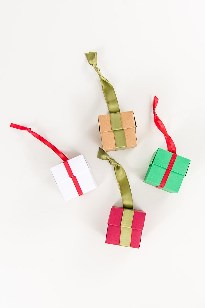 folding box gift ornaments red white brown and green on table