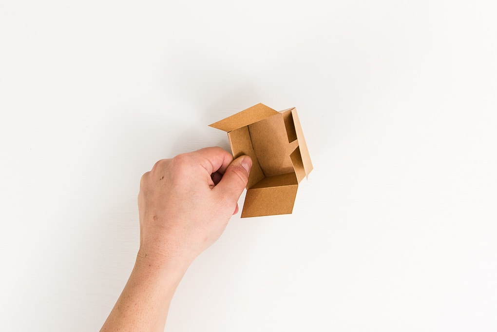 taping a brown 3D paper box lid