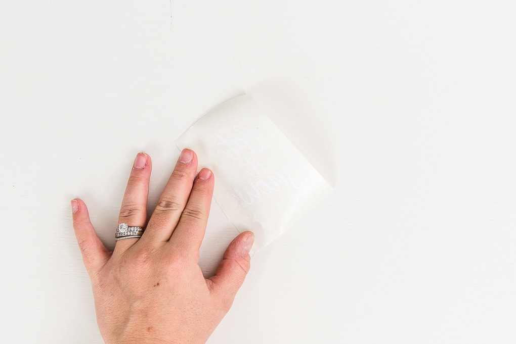 white vellum tag placed over white vinyl design