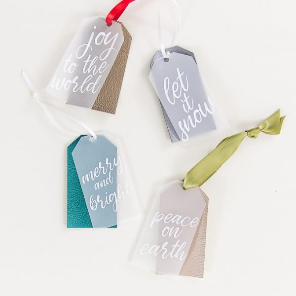 four layered Christmas gift tags with faux leather and vellum