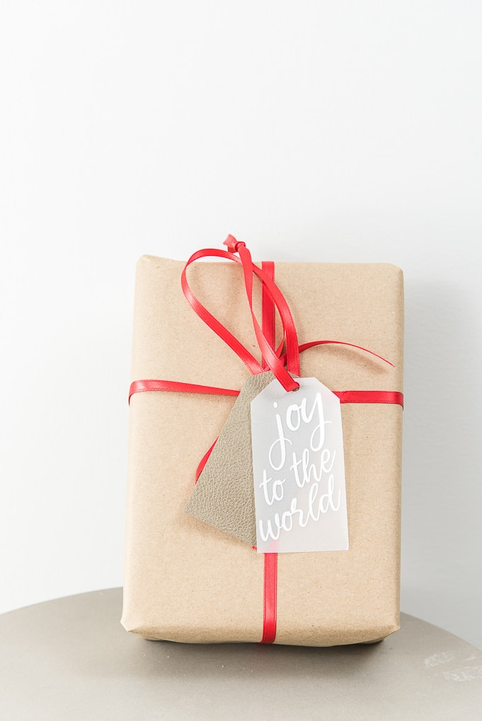 joy to the world layered gift tag on brown Christmas gift box