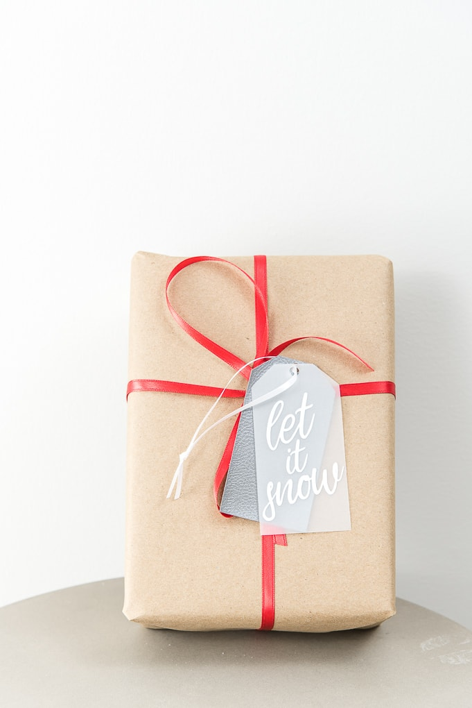 let it snow layered gift tag on brown Christmas gift box