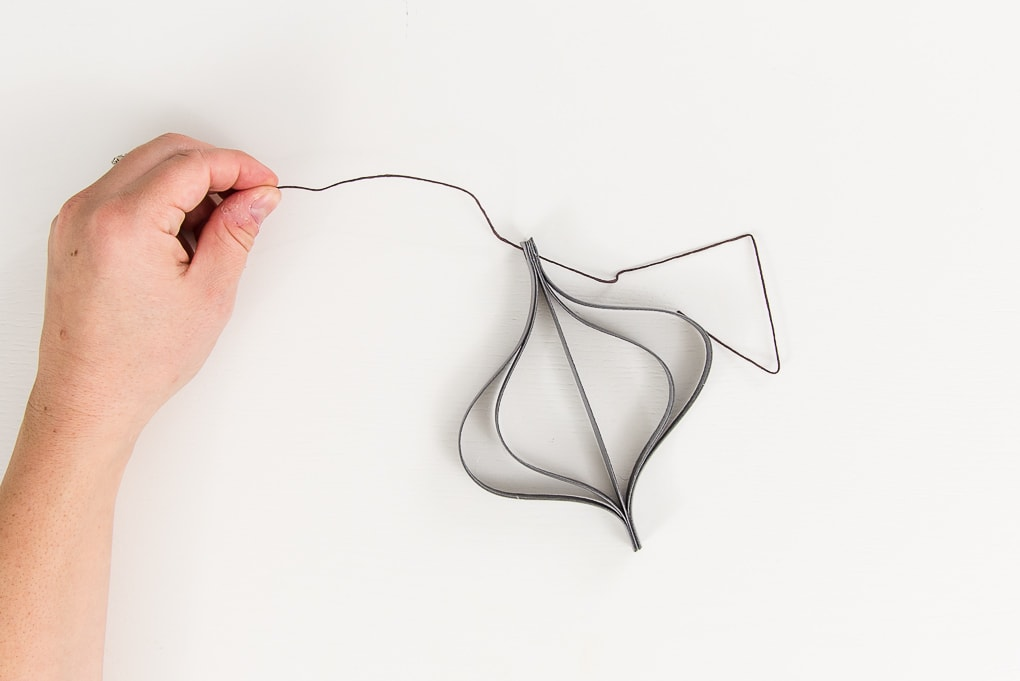 adding string to a gray modern leather Christmas ornament