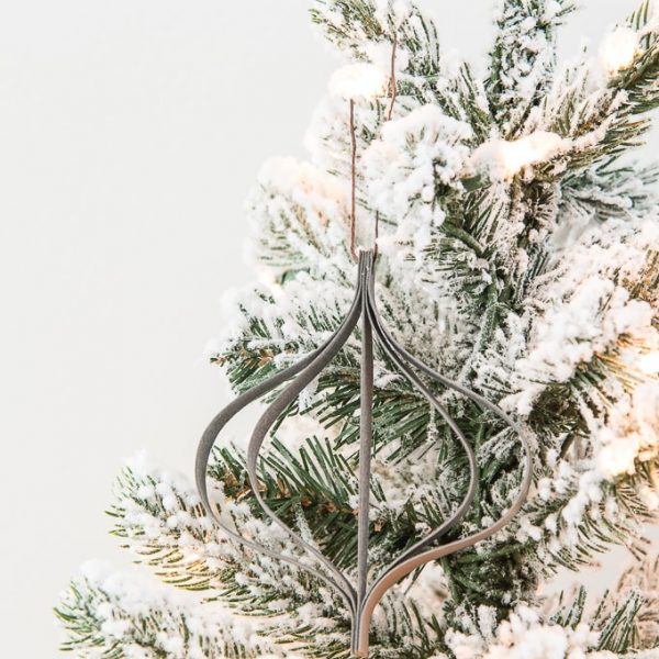 gray modern leather ornament on a flocked Christmas tree