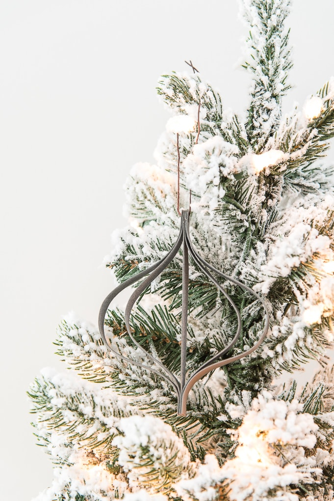 close up of modern leather ornament on a flocked Christmas tree
