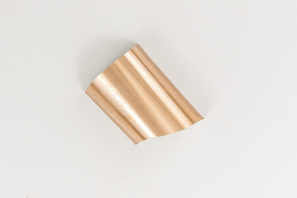 gold adhesive foil material piece