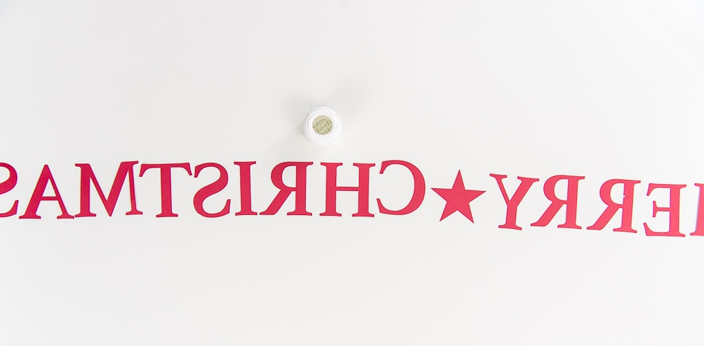 backward Merry Christmas banner letters and string