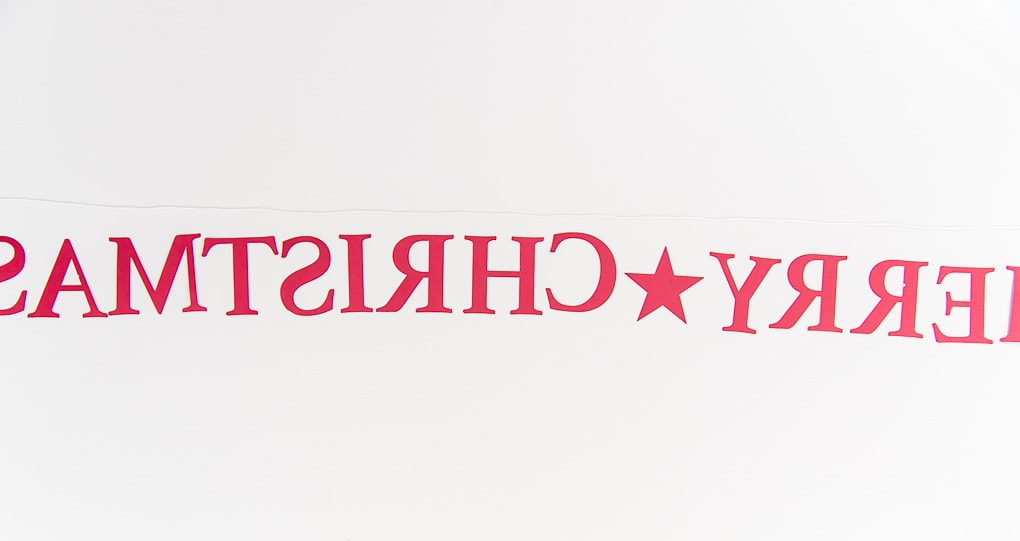 lining up Merry Christmas banner letters