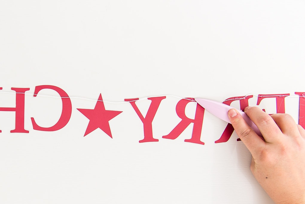 assembling letters Merry Christmas banner