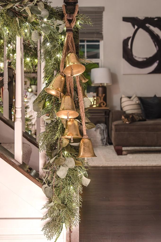 gold bells on greenery Christmas garland