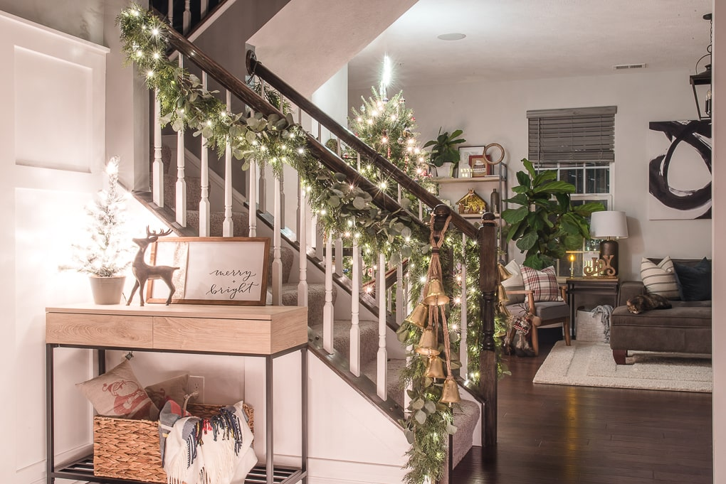 Christmas home at night with lights garland and Christmas tree