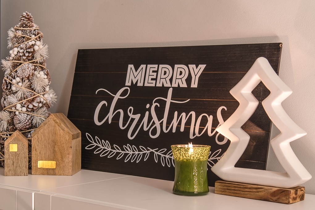 modern merry Christmas sign at night with candle