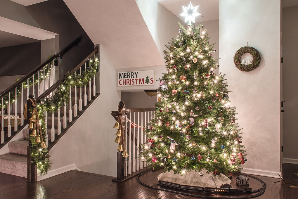 Christmas living room at night Christmas tree and Christmas garland on staircase