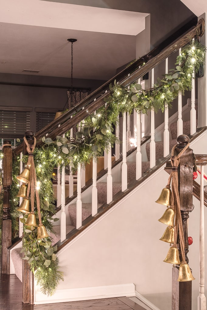 Christmas garland on staircase lit up at night