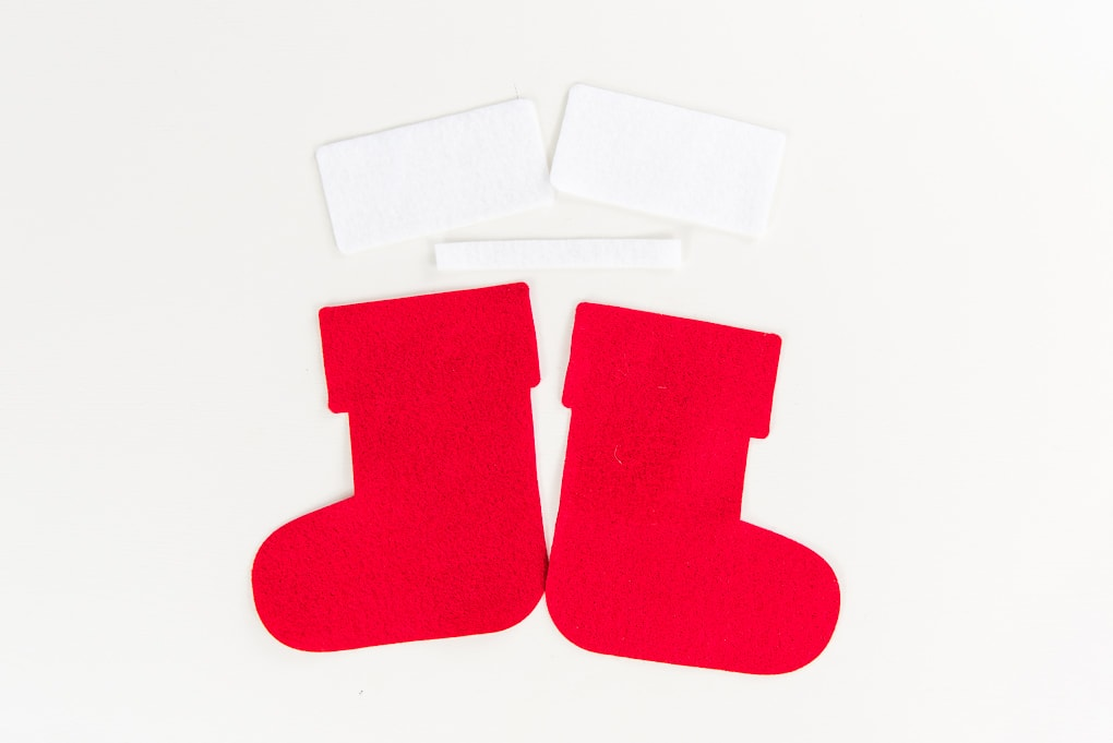 red and white felt cutouts for mini stocking