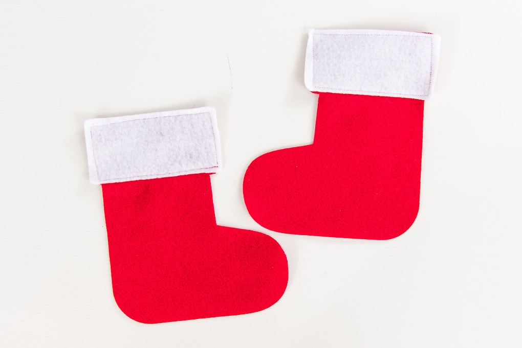 white cuffs sewn onto red felt stocking cutouts