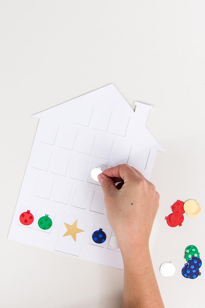 assembling the white house modern advent calendar placing ornaments