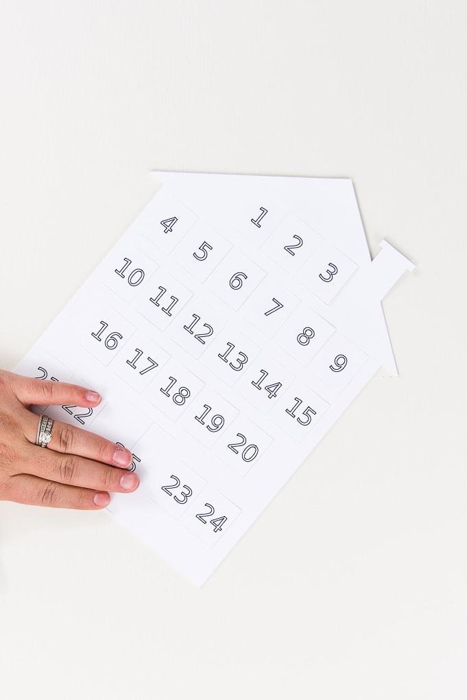 white house modern advent calendar with hand