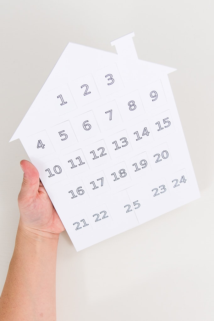 white modern advent calendar held by a hand