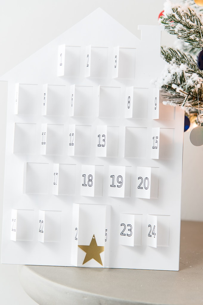 white modern advent calendar windows open with star ornament