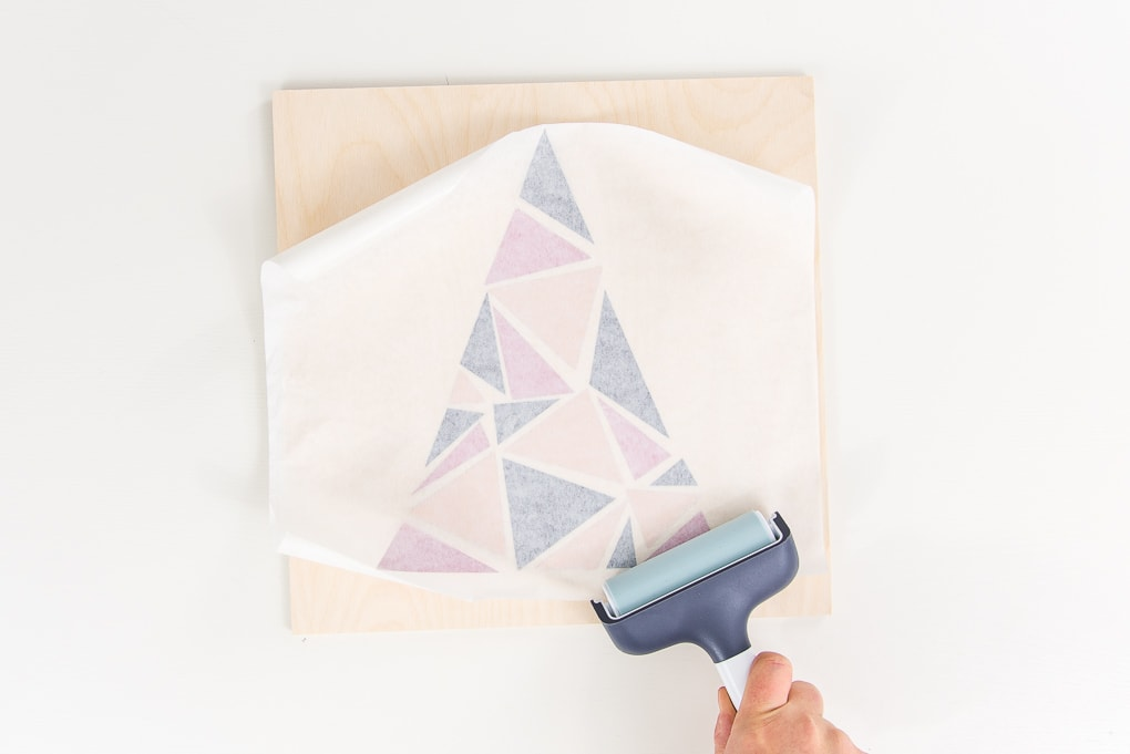 brayer tool transferring design onto craft plywood