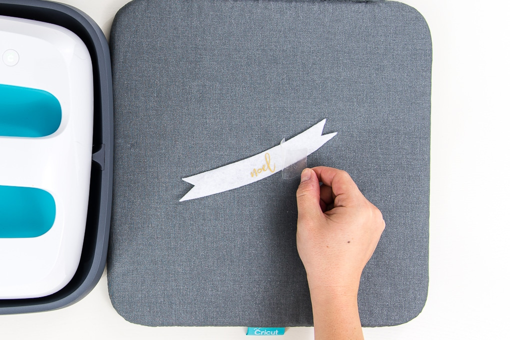 peeling transfer sheet off of iron on design on felt