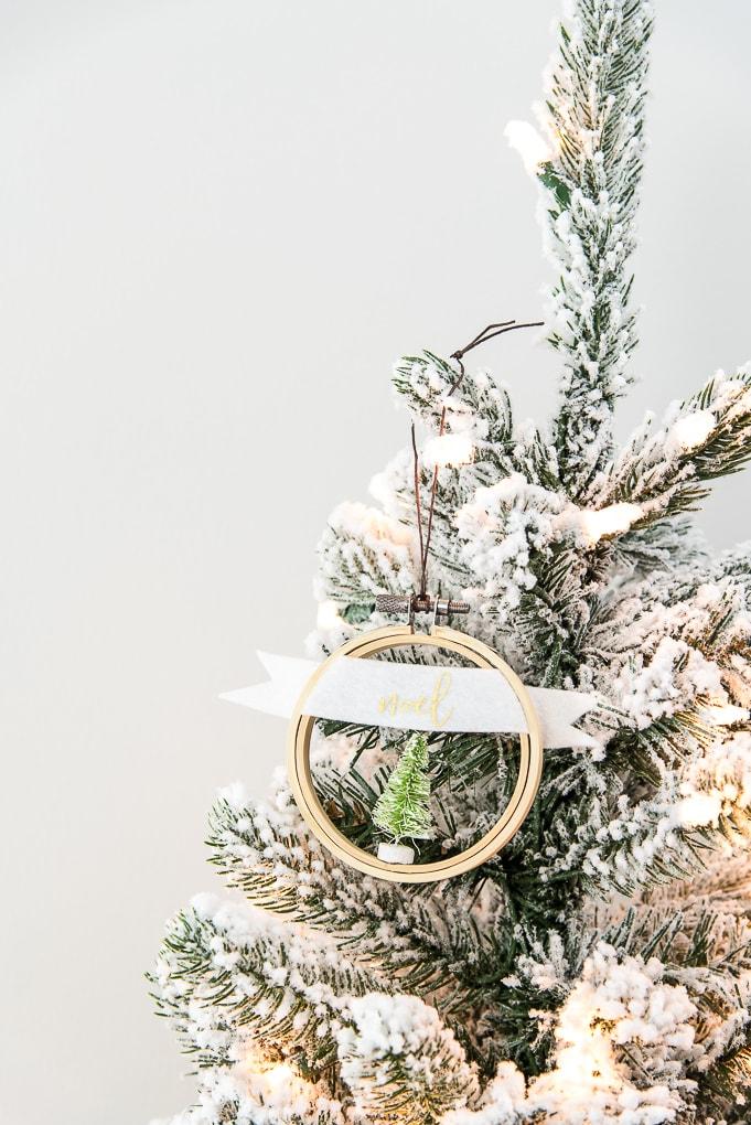 noel embroidery hoop ornament hanging on flocked Christmas tree