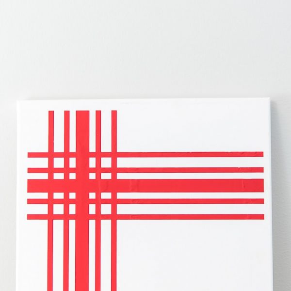close up of white canvas with red plaid iron on design