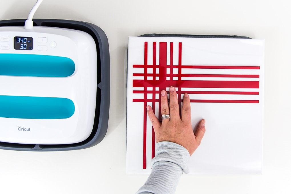 placing red iron on design on canvas