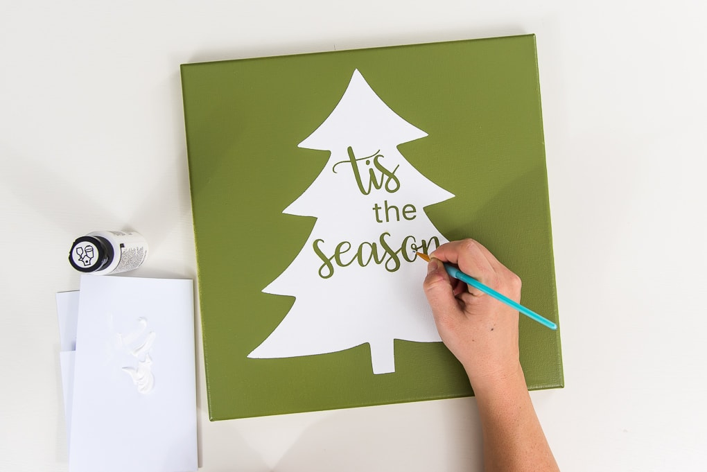 green canvas with white Christmas tree stenciled design paint touch up