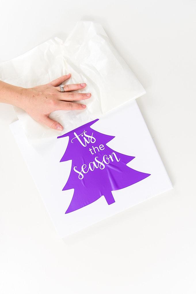 peeling transfer tape off of purple vinyl design