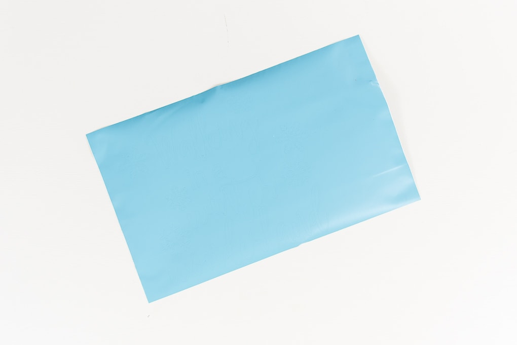 light blue vinyl material piece