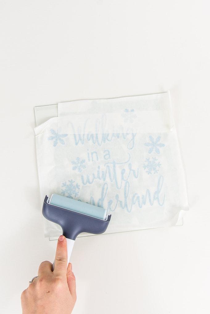 brayer tool light blue vinyl design onto shadow box glass front