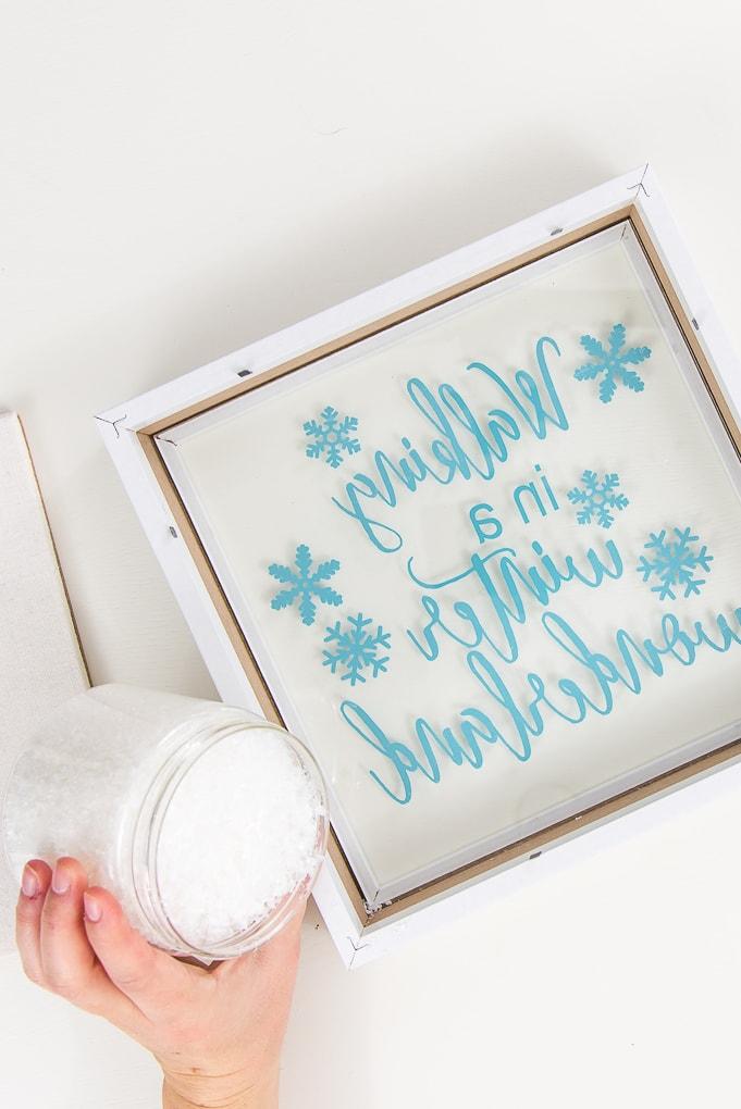 adding fake snow into a shadow box