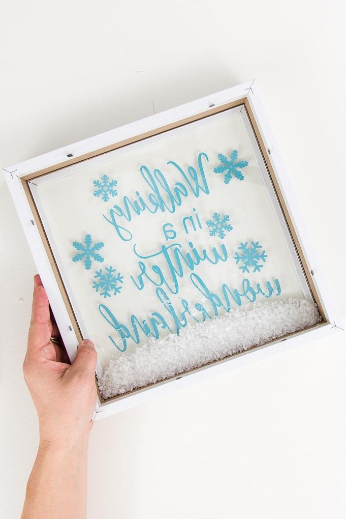 fake snow at the bottom of a shadow box