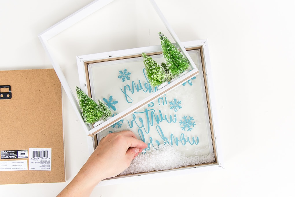 fake snow on the inside of a shadow box