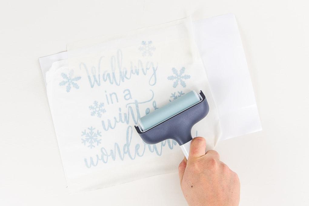 brayer tool on light blue vinyl design