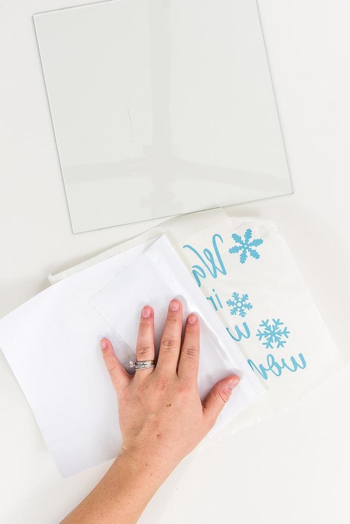 peeling transfer tape off light blue vinyl design