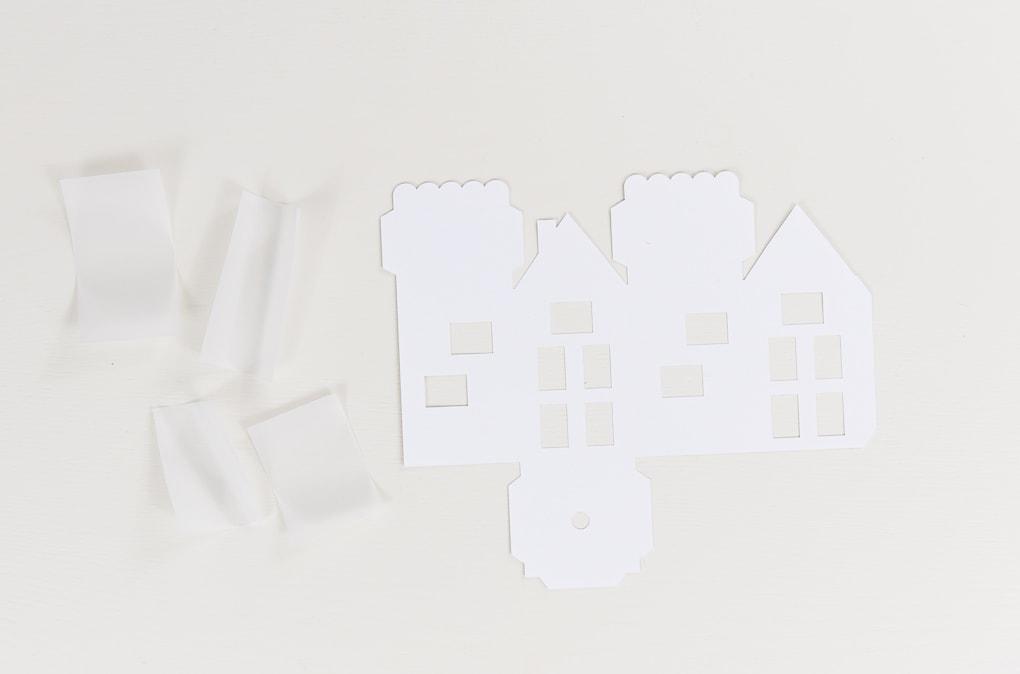 white 3D paper house cutout pieces