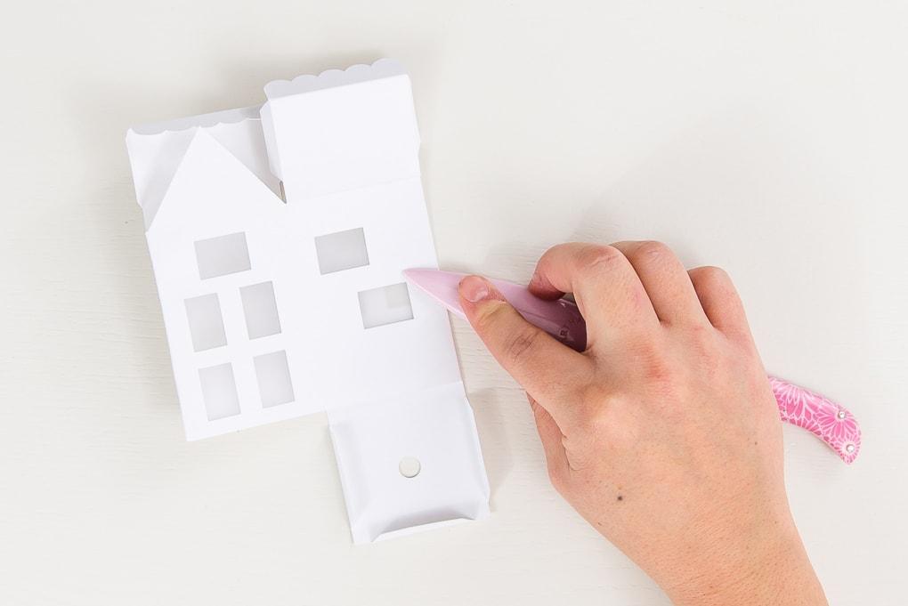 hand folding paper 3D winter house with bone folder