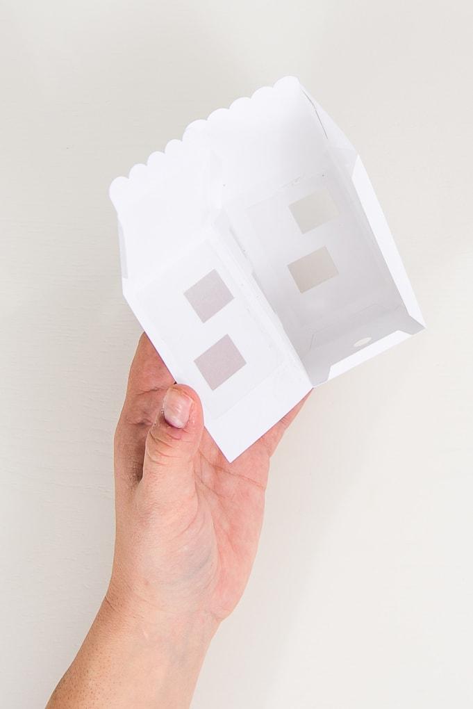 hand assembling paper 3D winter house wall open