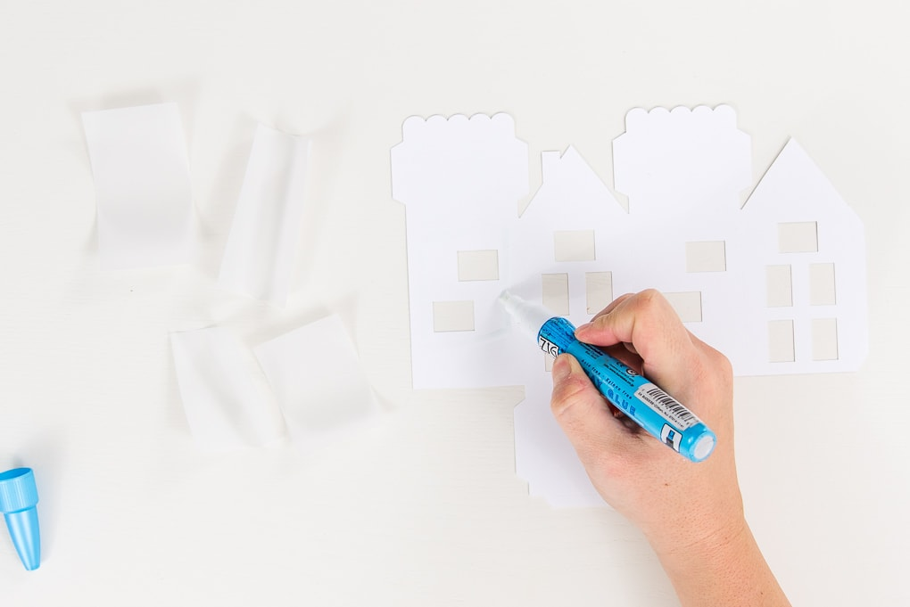 attaching vellum windows to paper house cutout with glue pen