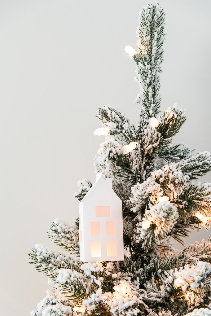 winter 3D light up house ornament attached to flocked Christmas tree