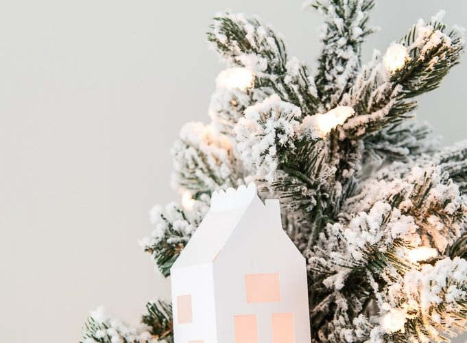 close up of winter 3D light up house ornament on flocked Christmas tree