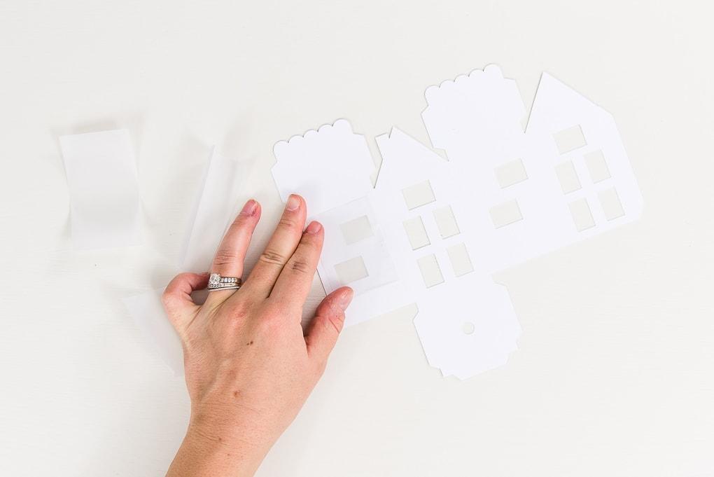 attaching vellum windows to paper house cutout