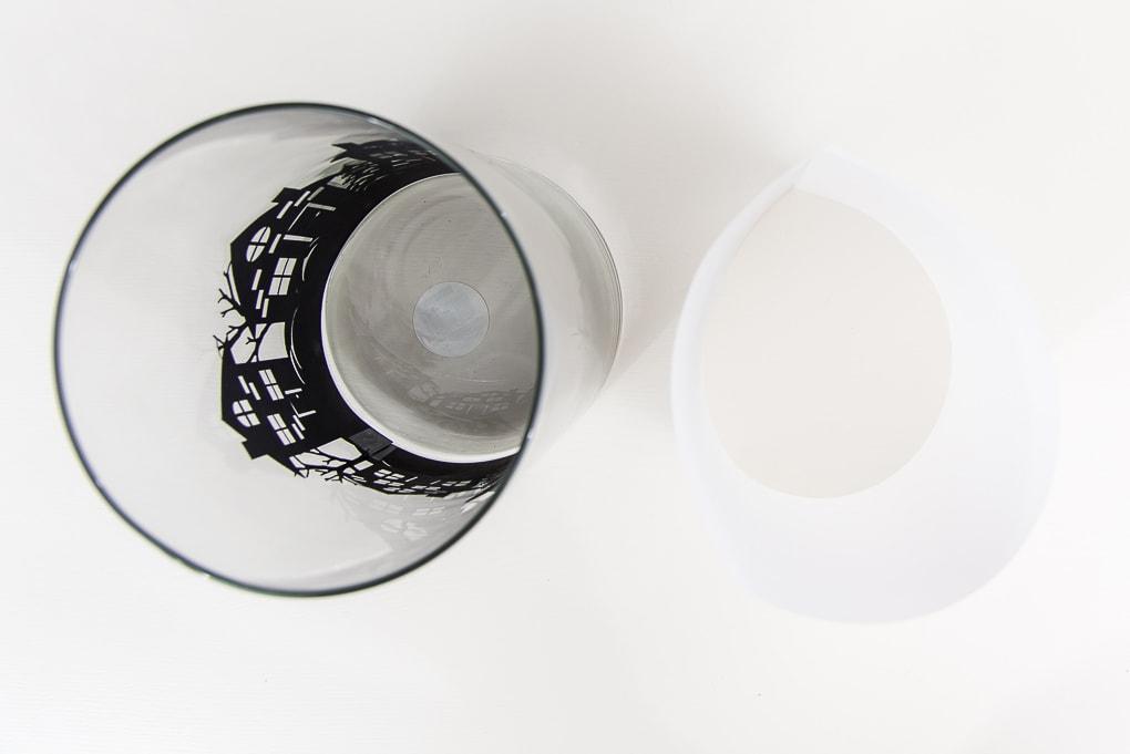 vellum paper next to hurricane vase