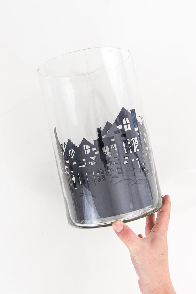 black paper cutout winter night inside hurricane vase