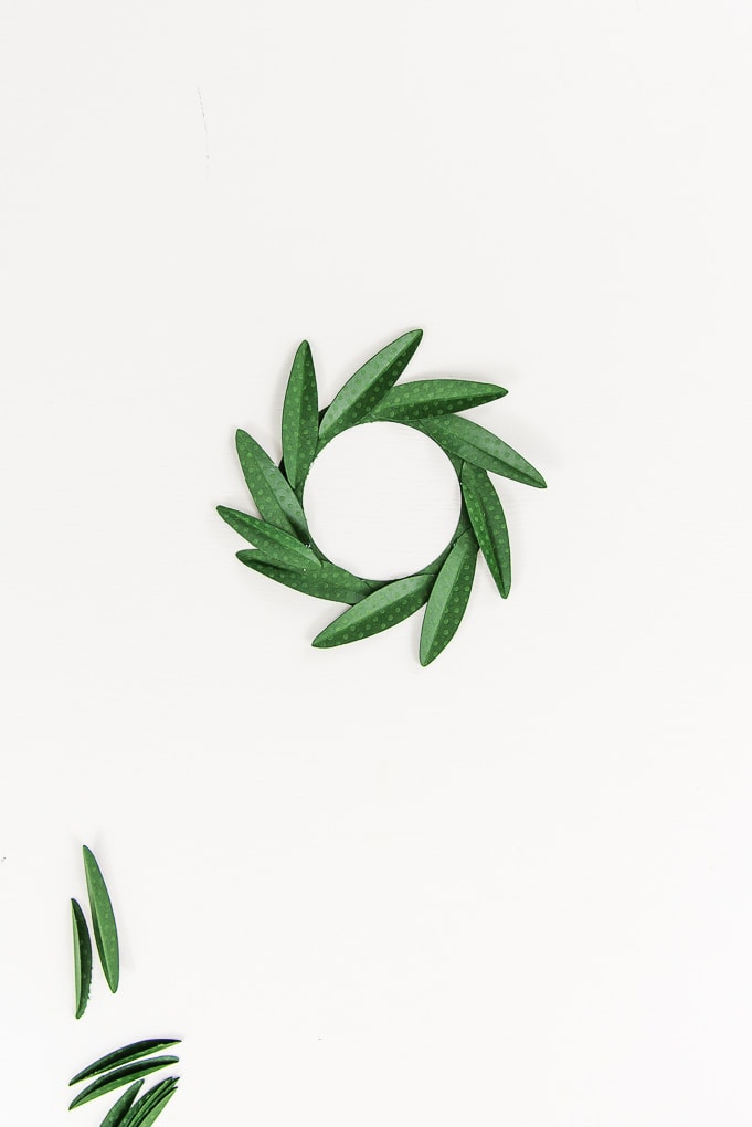 green paper leaves on wreath base