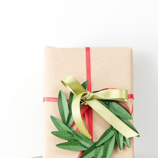 diy green paper wreath gift topper on brown Christmas present box